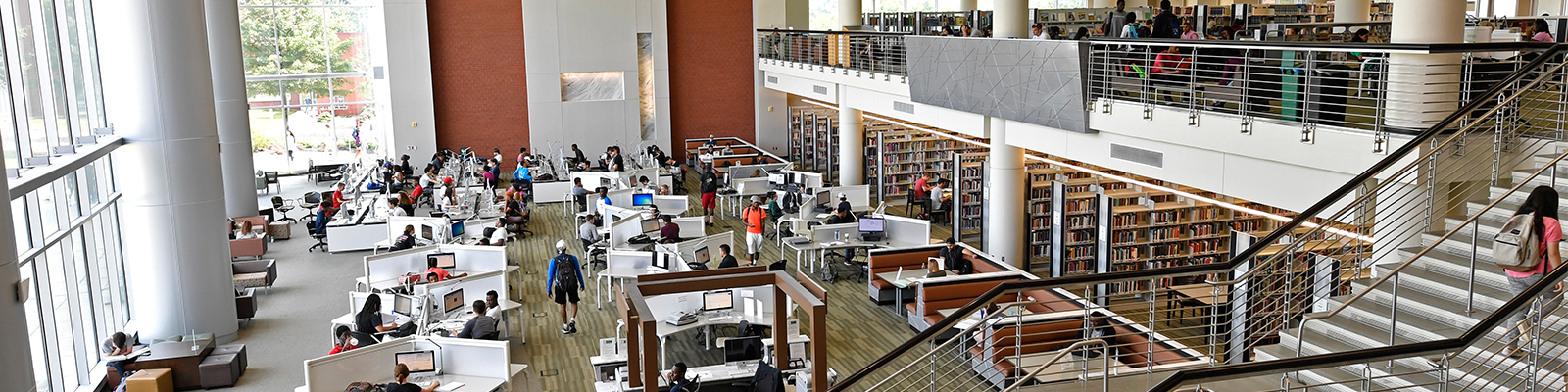 Students actively studying in the computer area of the Library.