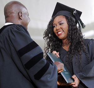 student accepting degree at commencement