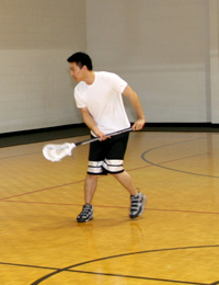 photo of student playing lacrosse