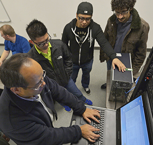 professor and students at computer terminal