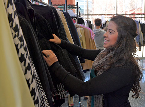 Student browsing business attire from the Lending Closet at campus-wide event.