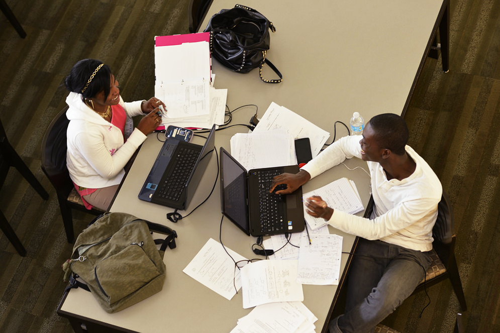 Students collaborating in the library
