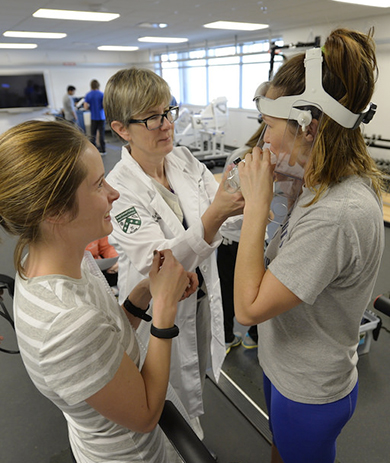 professor and exercise science students conducting breath test