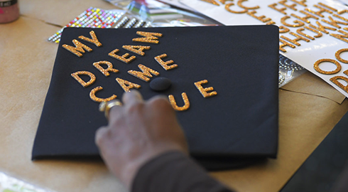 "Graduation cap decorated with the words, ""My dream came true."""
