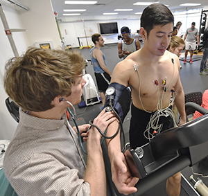 exercise science students conducting stress test