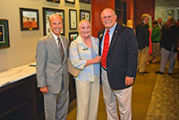 Outgoing Georgia Gwinnett College President Daniel J. Kaufman pauses for a photo with Lee and Marshall Boutwell at a Thursday night event at the college.