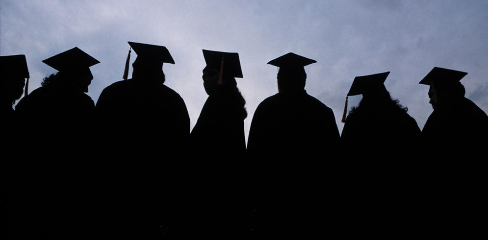 Graduates silhouetted