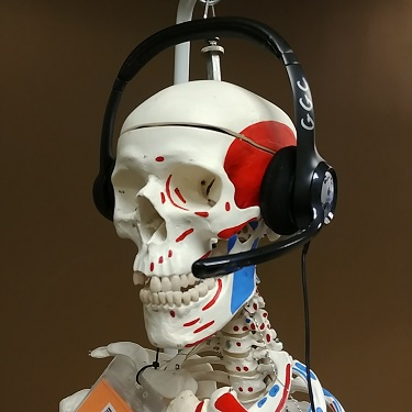 skeleton wearing a pair of headphones