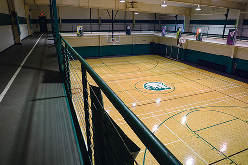 Indoor walking track above basketball court