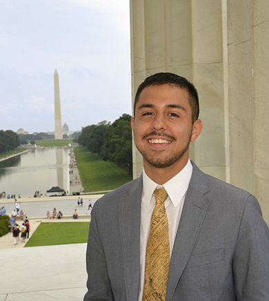 student Washington DC intern in front of the Washington Monument
