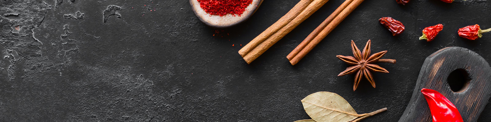 Spices and red pepper on cutting board