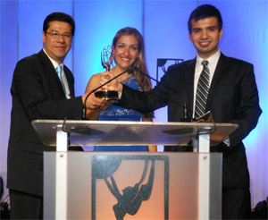Photo of Jorge Buzo, Nataly Hart and Homero Gonzalez accepting the Emmy award