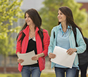 2 female students walking