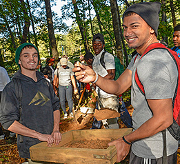 Anthropology students sift for artifacts during campus outdoor classroom project.